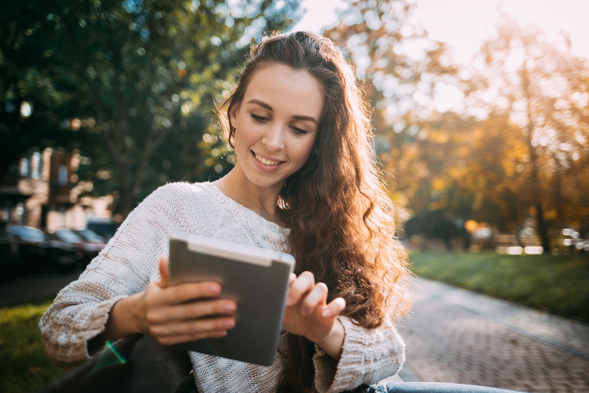 Young woman looking at a tablet - SEO Baltimore - Eyler Creative